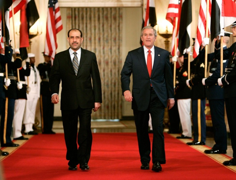 George W. Bush and Nouri al-Maliki. Birds of a feather... After Bush, Obama became a Maliki booster.
