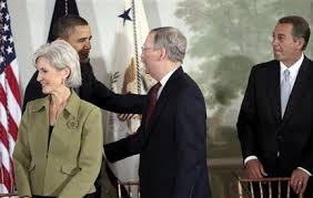 President Barack Obama shaking hands with Senate leader to be Mitch McConnell while House leader John Boehner looks on. Do they have a deal for you!