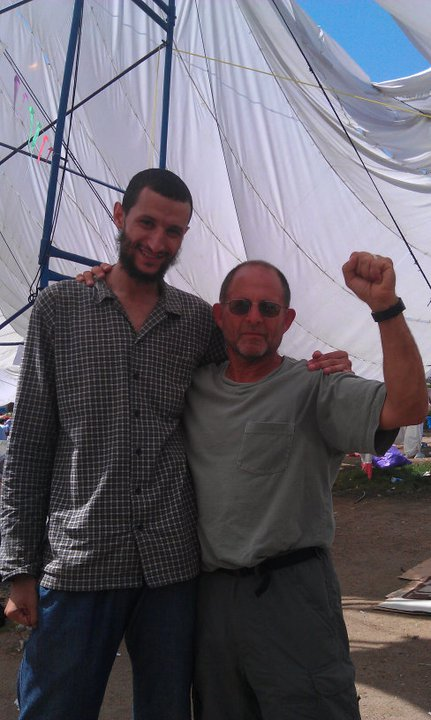 """This foot was taken in Tahrir Square in Cairo during the occupation during the """"Arab Spring."""" This man is a devout Muslim. He and a friend gave the author of this article (pictured here) a long lecture about how Zionism controls the US. (Once they said """"Jews"""" and several people in the crowd corrected them and said """"Zionism"""", not all Jews.) They said that the US had invaded Iraq at the insistance of Israel.Our reply was that Israel was important to US capitalism to keep control over the region and the region was important because of oil. If it weren't for oil, US capitalism wouldn't care so much about Israel. They talked about the crimes of the US government in the region - how the US """"hates Muslims, and I replied by listing many of the crimes of this government throughout history - slavery, genocide against the Native Americans, machine gunning striking US workers, coups in Latin America, Vietnam, etc. It was nothing against Muslims in particular, it was just the striving for world domination on the part of the most powerful capitalist state. After all of this, this man above told me he hopes I read the holy Koran one day. I thanked him and said I hope he reads the Communist Manifesto, to which he agreed. (That got a good laugh from everybody, including him.) He then said I'd """"entered into his head"""" (evidently meaning I'd made a strong impression on him) and insisted on having this photo of the two of us taken."""
