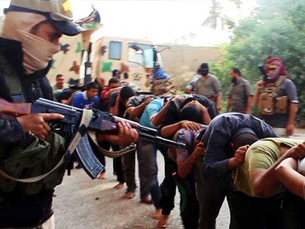 Leading to a slaughter?Islamic State soldiers with captives.
