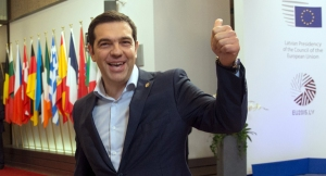 Tsipras puts on a happy face as he leaves latest negotiations with EU sharks.