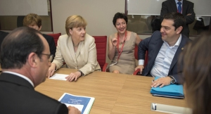 Tsipras meeting with shark-in-chief Merkel. Can they make a deal?