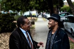 Bobby Seale (left) with singer D'Angelo today.