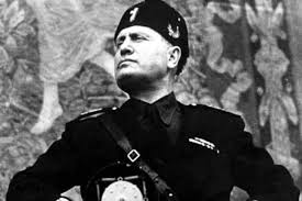 "The fascist Benito Mussolini: The Newsweek writer claims Trump is a fascist as was Mussolini. Although he shares some personality traits with Mussolini - the bragging, the extreme ego, etc. - Trump bases himself on different social forces. Whereas Mussolini gathered around him a gang of thugs who beat up and killed union activists, for instance, Trump is confined to the normal ""democratic"" methods of legal maneuvering, firing union supporters, etc. The same difference is seen in the modern day world, where the Islamic State - a fascist force if there ever was one - rules through terror; Greece's Golden Dawn carries out organize attacks on the immigrant community; and the Israeli settler movement does the same against Palestinians while they call for ""death to (all) Arabs."" While Trump undoubtedly has fascists of this type around him, the conditions are not ripe enough in the US for such a fascist movement on a wide scale."