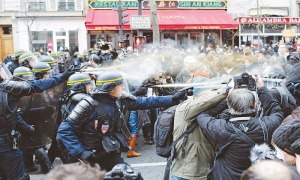 Police tear gas climate protesters outside Paris Climate negotiations
