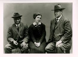 """IWW leader Big Bill Haywood (R), with two IWW supporters. He said to the Southern timber workers: """"You work in the same mills together. Sometimes a black man and a white man chop down the same tree together. You are meeting in convention to discuss the conditions under which you labor. This can't be done intelligently by passing resolutions here and then sending them out to another room for the black man to act upon. Why not be sensible about this and call the Negroes into this convention? If it is against the law [which it was], this is one time when the law should be broken."""" They ended up breaking the law and building an integrated union."""
