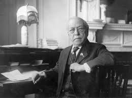 AFL president Samuel Gompers. As he moved towards business unionism and opposing strikes, he also moved to accept racism.