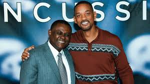 Actor Will Smith (R) with the real Dr. Bennet Omalu