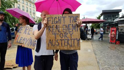 """Fight the real enemy"". This couple were part of a protest against the Brexit vote in Berlin, Germany. The protesters were Britons living there. These two people get it. Why can't so many socialists?"