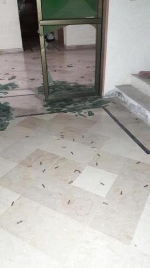 Shells litter the floor of the home of the family of Mehr Abdul Sattar after police raided their home.