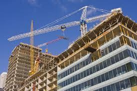 A construction job in progress. Despite a building boom, the building trades membership has shrunk.