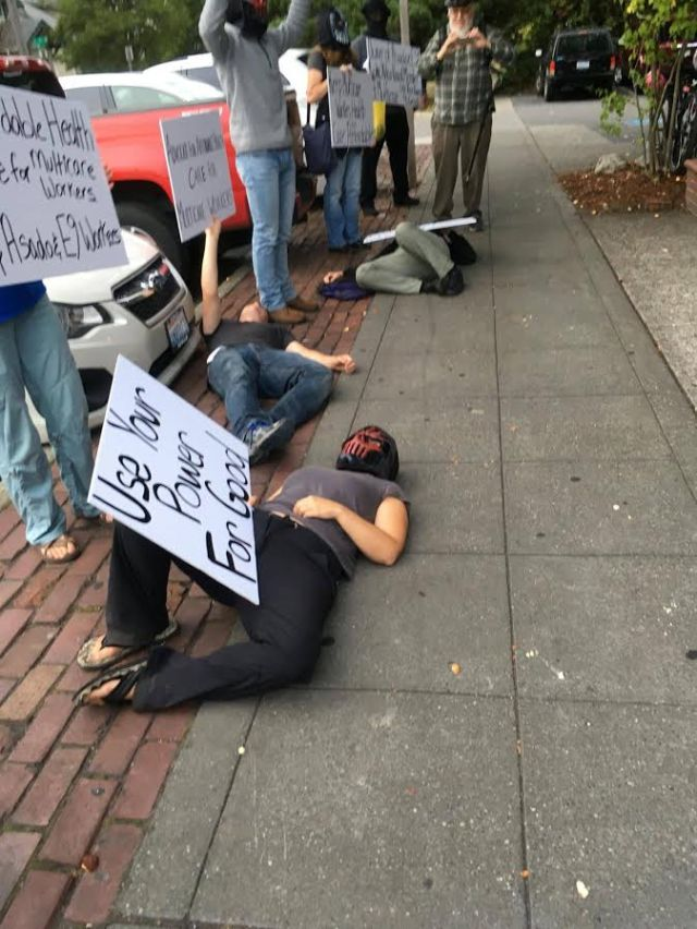 Multicore workers and supporters protest outside restaurant of