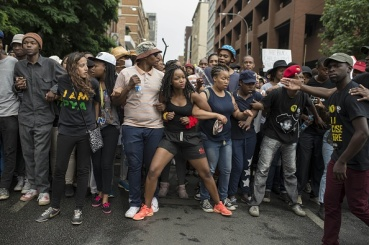 JOHANNESBURG, SOUTH AFRICA - OCTOBER 21: Students of the Witwatersrand University march in Johannesburg, South Africa on October 21, 2015 during a protest against fee hikes. Universities in Cape Town, Johannesburg, Pretoria and other cities have halted lectures during several days of protests against fee increases that many students say will force poor blacks further out of the education system (Photo by Ihsaan Haffejee/Anadolu Agency/Getty Images)