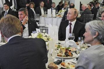 Mike Flynn (with hand to ear) appearing at the RT gala in Moscow with Putin. (At lower right is Green Party's Jill Stein.)